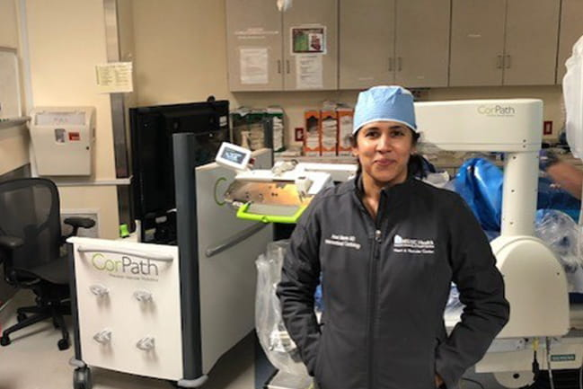 Dr. Arasi Maran with the Robotic Vascular Interventional System.